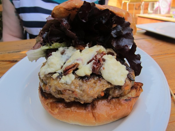 Carnitas Snack Shack Pork Burger with candied bacon, gorgonzola, and greens